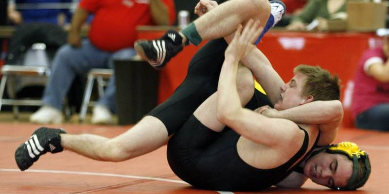 School goes down for count as wrestler wins right to trial